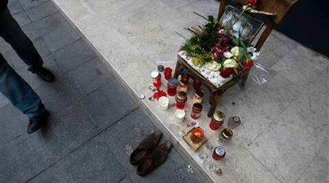 Flowers and candles decorate a wooden chair with photo of late Husein Hasani, in downtown Sarajevo