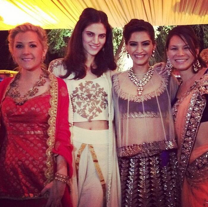Sonam looks ravishing in the indigo outfit by Anamika Khanna as she strikes a pose with her gang of girls.