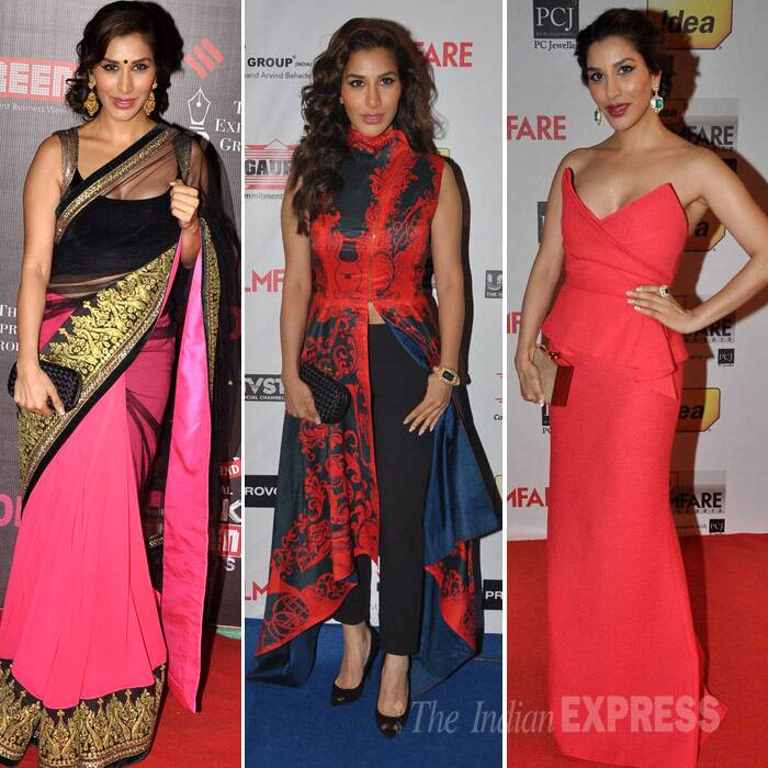 <b>Sophie Choudry</b>: Sophie Choudry picked a pink and black Manish Malhotra net sari with a rich gold border. Danglers and a black Bottega Veneta clutch rounded off her look. <br /> The actress later blew us away when she turned up at a nominations bash in a printed Pankaj and Nidhi jacket over cropped black slim pants. <br />Sophie was drop dead gorgeous in a red strapless BCBG gown, which she accessorised with Diamond and emerald drop earrings. (Photo: Varinder Chawla)