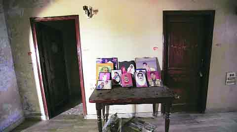 Portraits of the eight killed in the family home in 2001.Neeraj priyadarshi/file