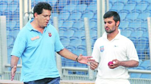 Maharashtra coach Bhave with skipper Rohit Motwani (IE Photo)