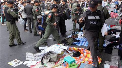 Thai Explosive Ordnance Disposal (EOD) and Forensic officials examine the bomb blast site near an anti-government rally site of Victory monument in Bangkok. (AP)