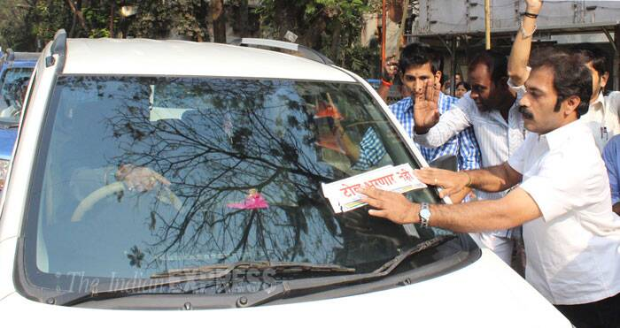 MNS activist put stickers on vehicles for not to pay any toll fares