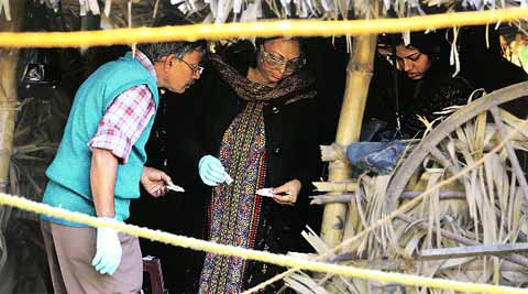 The forensic team at Labhpur village Saturday.(IE Photo:Subham Dutta)