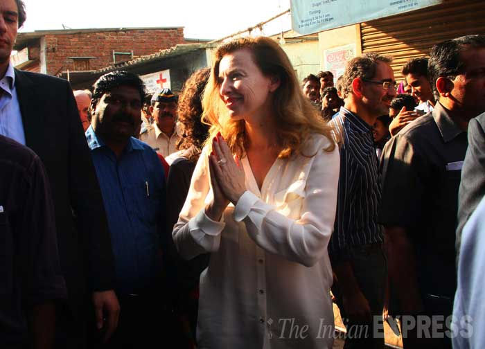 Ms  Trierweiler greets people at the slums with a traditional namaste. (IE Photo: Pradip Das)