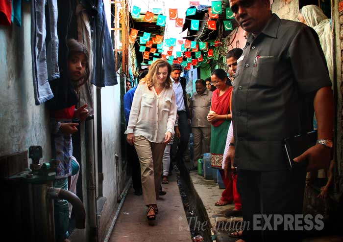 France's former first lady, Valerie Trierweiler, talks to residents during a visit to the Ekta Nagar slums in the Mandala area of Mumbai on Tuesday (January 28, 2014). Trierweiler, the former partner of France's President Francois Hollande, was in India for humanitarian work with the charity Action Against Hunger. (IE Photo: Amit Chakravarty)
