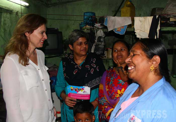 Valerie Trierweiler, the ex-partner of French President Francois Hollande, with health workers and children during her visit to the Ekta Nagar slums in the Mandala area of Mumbai. (IE Photo: Pradip Das)
