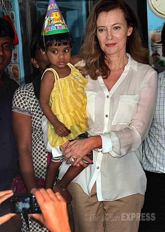 Valerie Trierweiler holds a child during her visit to the slum. (IE Photo: Pradip Das)