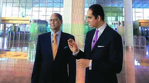 The father-son duo of GVK Group behind Terminal-2 tell  The Indian Express Editor-in-Chief Shekhar Gupta, on NDTV 24X7's Walk the Talk, about the problems they faced, and the art that puts their airport apart. IE