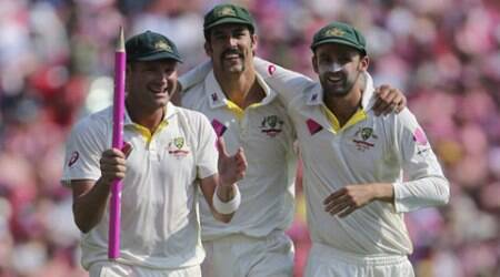 Australia cricket players Ryan Harris left, Mitchell Johnson center, and Nathan Lyon walk together after Australia won the fifth and final Ashes Test in Sydney (AP)