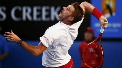 Stanislas Wawrinka of Switzerland serves to Tomas Berdych of the Czech Republic during their men's singles semi-final match at the Australian Open 2014 (Reuters)