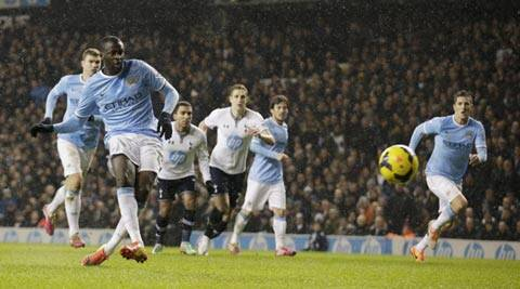 Manchester City's Yaya Toure, second left, scores his side's second goal from a penalty during the English Premier League soccer match between Tottenham Hotspur and Manchester City (AP)