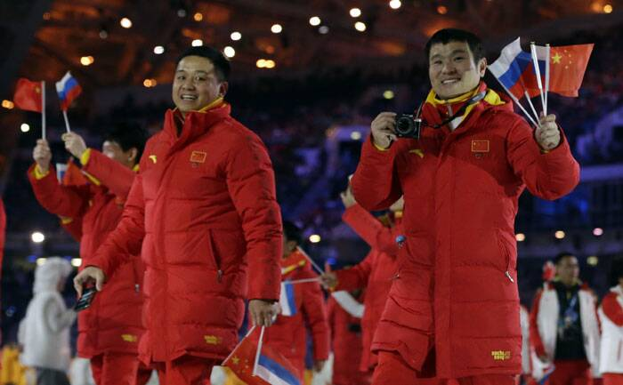 Members from the Chinese team cheer during the opening ceremony of the 2014 Winter Olympics in Sochi, Russia. (AP)