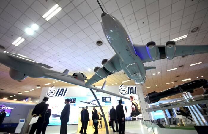 Antony said India has always desired peace with its neighbours but peace cannot come at the cost of its security concerns. <br /> Models of aircrafts on display at Defexpo India 2014 in New Delhi on Thursday. (IE Photo: Oinam Anand)