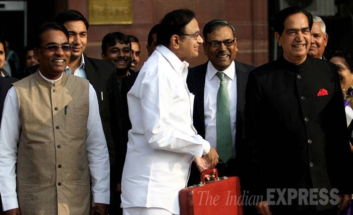 """In keeping with the conventions, I do not propose to make any announcements regarding changes to tax laws,"" he said in UPA-II's last budget that sought to provide sops in indirect taxes including reliefs in service tax to storage and warehousing of rice and blood banks. <br /><br /> Finance minister P. Chidambram with ministers of state N.N. Meena and J.D. Seelam before leave his office to present interim budget in Parliament, in New Delhi. (IE Photo: Ravi Kanojia)"