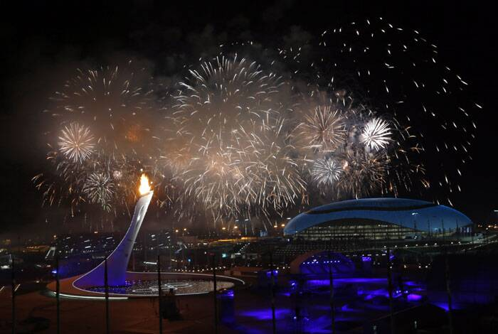 "A raucous group of Russian athletes had a message for their nearly 3,000 rivals in Sochi, marching through Fisht Stadium singing that they're ""not gonna get us!"" <br /> Fireworks light up the sky over the Olympic Park during the opening ceremony of the 2014 Winter Olympics in Sochi, Russia. (AP)"
