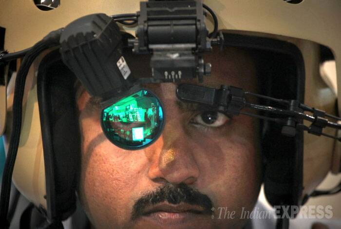 A delegate tries a Helmet Mounted System for helicopters by Elbit Systems at Defexpo India 2014 in New Delhi on Thursday. (IE Photo: Oinam Anand)