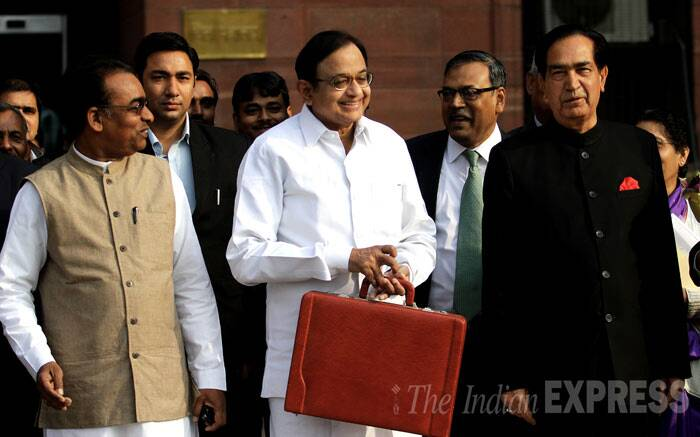 On continuance of the tax on 'super-rich' and corporates, he said he has left it to the new government to review the impost that was slapped in the last budget. The concessions will be valid up to June 30 and can be reviewed by the new Government. <br /> Finance minister P. Chidambram with ministers of state N.N. Meena and J.D. Seelam before leave his office to present interim budget in Parliament, in New Delhi  (IE Photo: Ravi Kanojia)