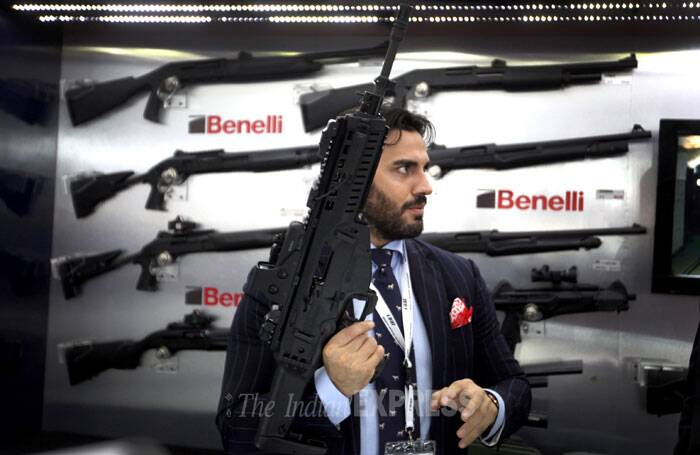 A representative from Beretta holds an ARX 160 assault rifle that is under trials with the Indian Army at Defexpo India 2014 in New Delhi on Thursday. (IE Photo: Oinam Anand)