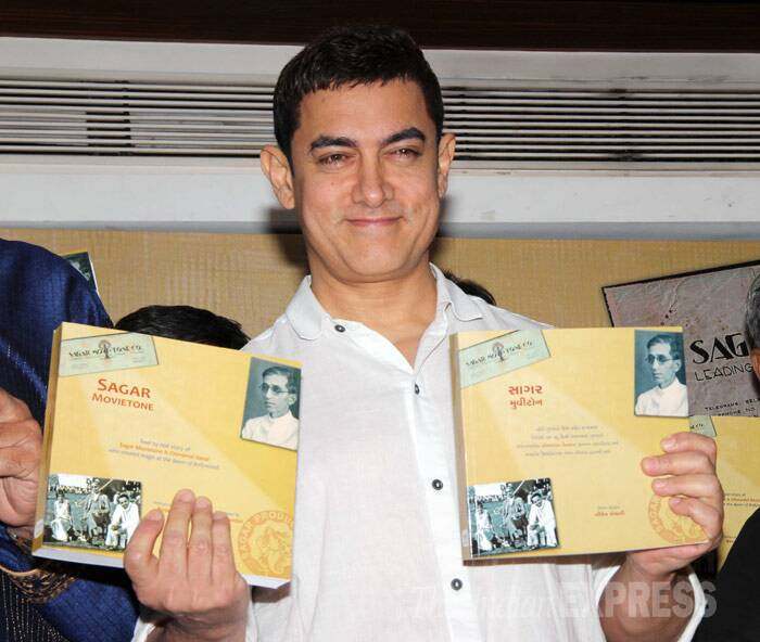 'Dhoom 3' actor Aamir Khan was spotted at the launch of Sagar Movietone, a book written by Biren Kothari, in Mumbai. (Photo: Varinder Chawla)