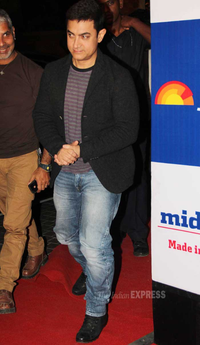 Bollywood's Mr. Perfectionist Aamir Khan, who is all set to commence the secong season of ,his social awareness show 'Satyamev Jayate',  opted for a casual look with jeans and t-shirt that he teamed with a black blazer. (Photo: Varinder Chawla)