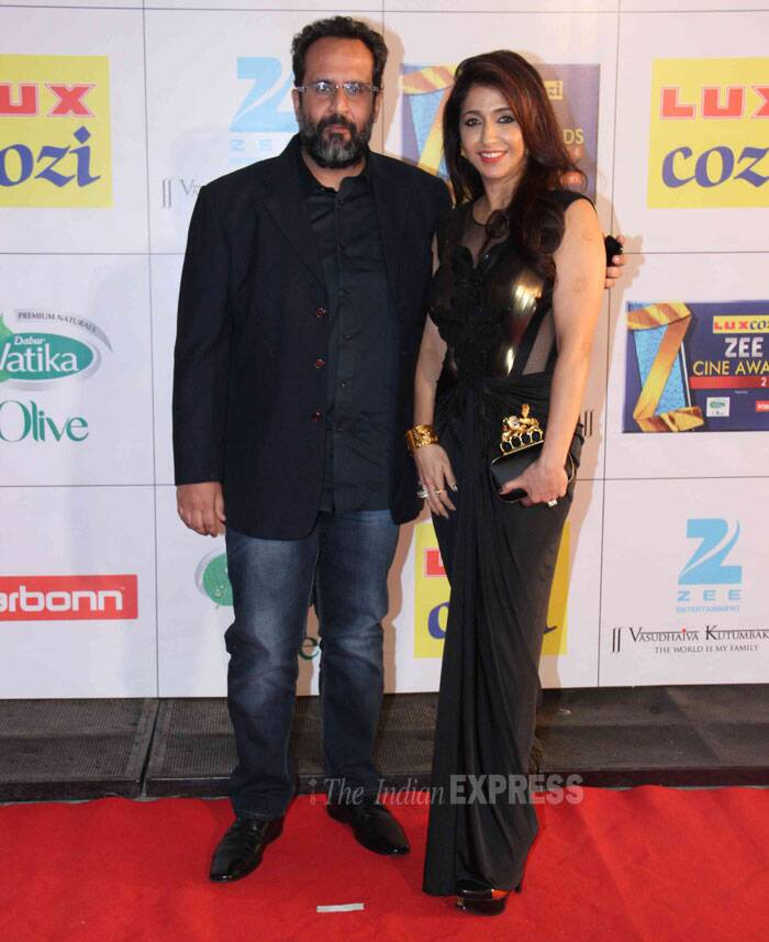 Producer Krishika Lulla poses with 'Raanjhanaa' director Anand L Rai.<br />Krishika looked nice in a black and gold gown. (Photo: Varinder Chawla)