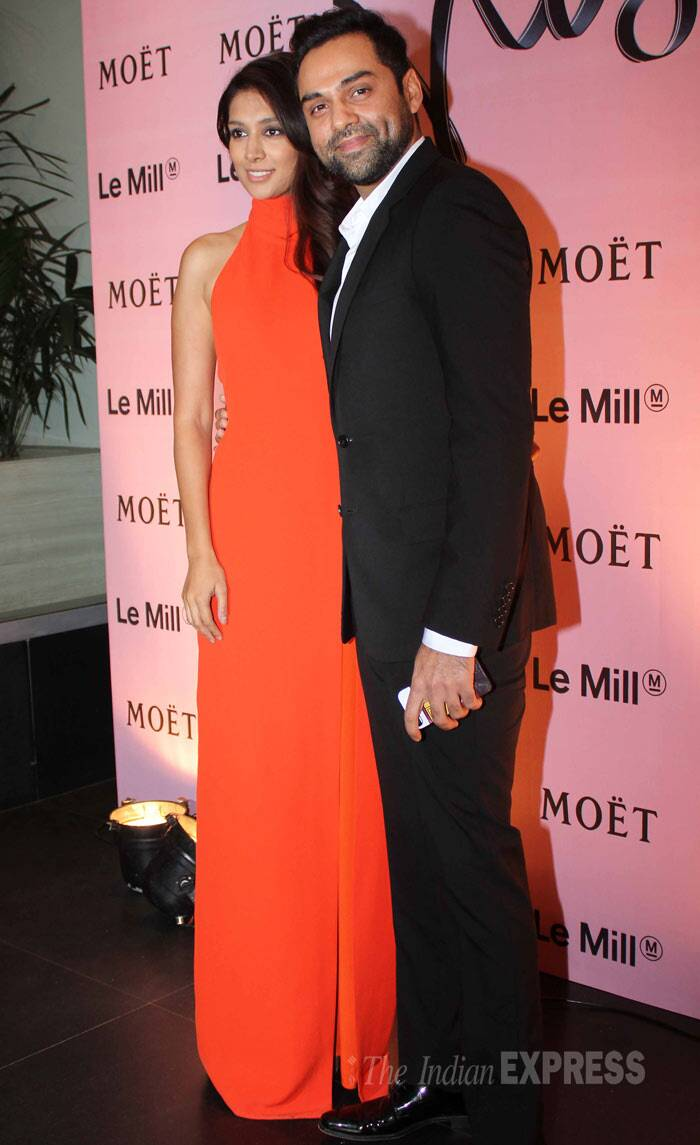Actor Abhay Deol was all suited as he posed with girlfriend Preeti Desai for the cameras. Preeti was lovely in a bright coloured halter evening gown. (Photo: Varinder Chawla)