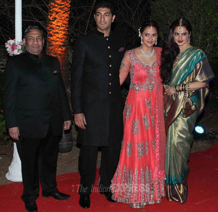 Hema Malini's good friend, the evergreen Rekha was stunning in her kanjeevaram as she posed for pictures with the couple. (Photo: Varinder Chawla)