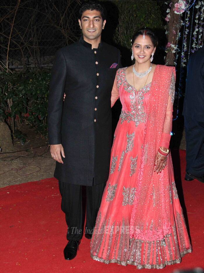 Bridal couple Ahana Deol and Vaibhav Vora look lovely together as they pose for the shutterbugs. The bride was gorgeous in a peach Manish Malhotra lehenga while the groom was dashing in a dark coloured sherwani. (Photo: Varinder Chawla)