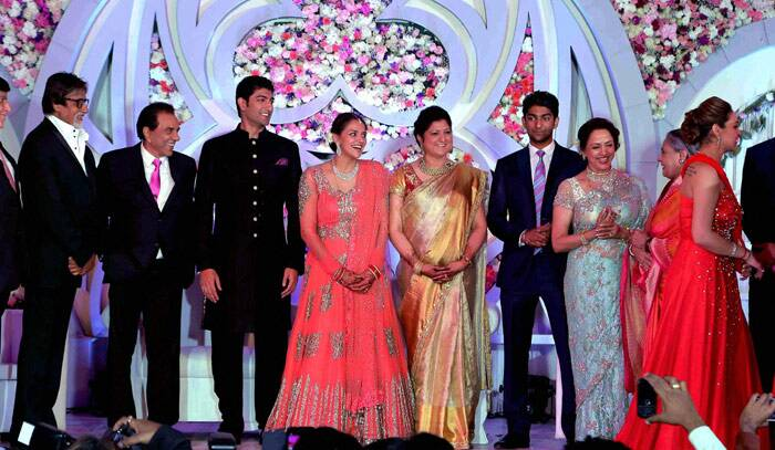 Jai And Veeru on stage - Amitabh Bachchan shares a light moment with father of the bride Dharmendra as they pose on stage with Vaibhav, Ahana, Hema and Jaya Bachchan. (PTI)