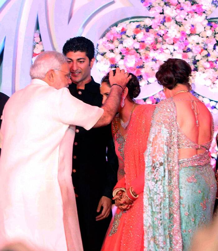 BJP's prime ministerial candidate Narendra Modi was also there to bless the newlyweds at their reception later in the day. (PTI)