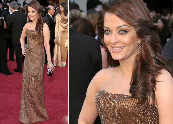 Aishwarya Rai was dazzling in a shimmering Armani Privé strapless dress at 83rd Annual Academy Awards. The Indian beauty, who has become synonymous with Bollywood elite on global platforms, was hands down gorgeous. Ash finished off her look with the right make-up, soft side curls and shimmering lip gloss. <br /> Aishwarya accessorised her look with a bracelet and black box clutch.