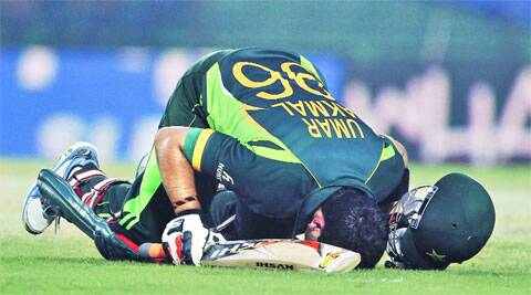 Pakistan's Umar Akmal kisses the ground after scoring a century against Afghanistan during their Asia Cup match on Thursday. AP