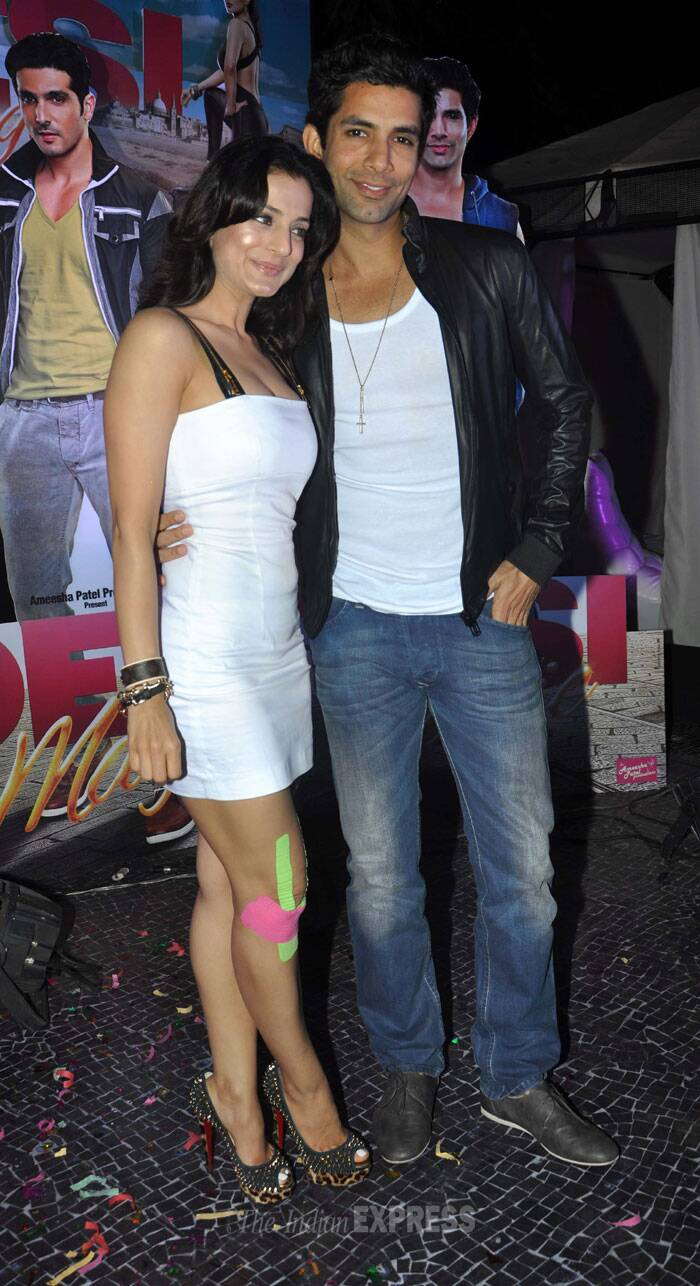 Ameesha seen here with co-star Sahil Shroff sizzled in a little white dress with gold spiked heels. (Photo: Varinder Chawla)