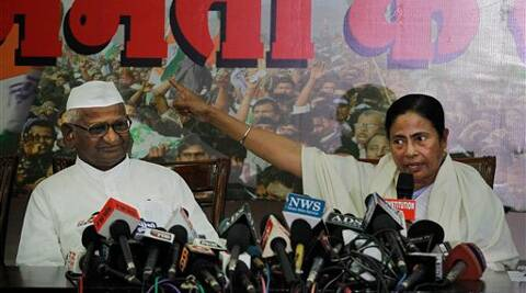 Hazare and Mamata Banerjee at the joint press conference, New Delhi, Wednesday. (AP)