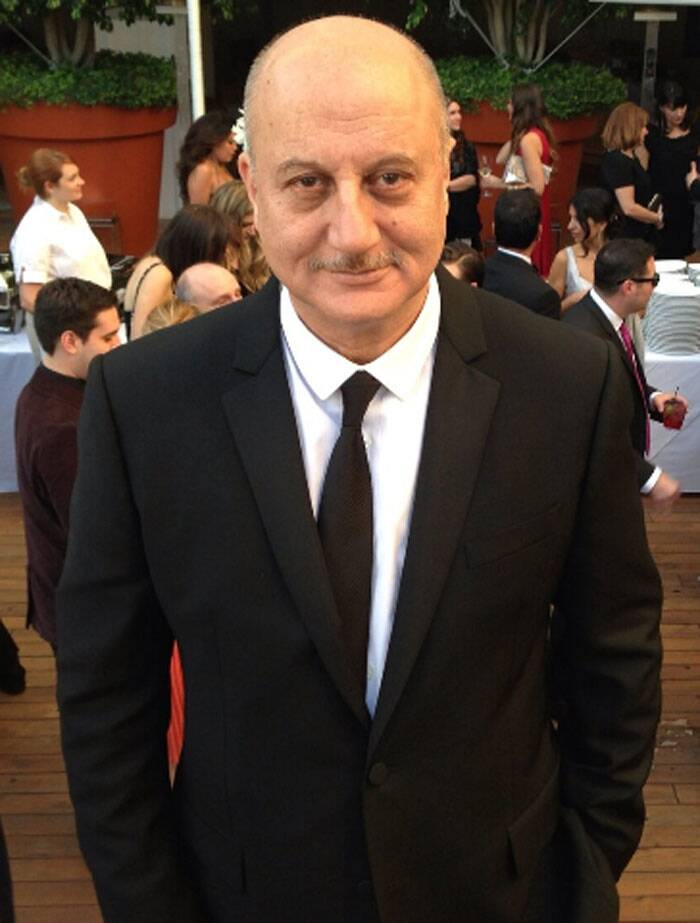 Bollywood actor Anupam Kher's claim to Oscars came via 2013 Oscars nominated film 'Silver Linings Playbook' in which he played a pivotal role. The actor was dressed by fashion brand Burberry in a tailor made suit for the actor. (Photo: Twitter)