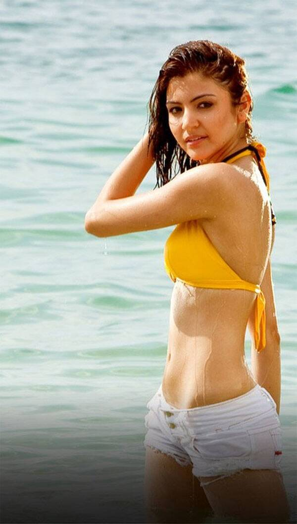 Anushka Sharma shed her girl-next-door image for a much sexier look in her third film Badmaash Company. Anushka was sizzling hot in a yellow bikini top with white hot pants. Anushka Sharma shed her girl-next-door image for a much sexier look in her third film Badmaash Company. Anushka was sizzling hot in a yellow bikini top with white hot pants.