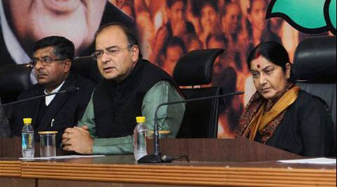 Senior BJP leader Arun Jaitley with Sushma Swaraj and Ravishankar Prasad addresses a press conference in New Delhi on Saturday.