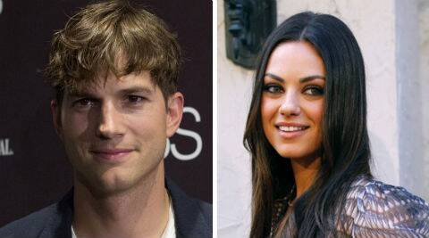 Sources say Ashton looked comfortable, while Mila mingled with guests at the wedding. (Reuters)