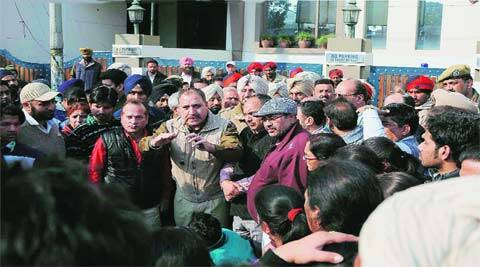 ACP Raj Kumar pacifies protesters outside the Kulwant Heart Centre in Ludhiana. (Gurmeet Singh)