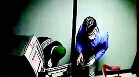 The four men, who were wearing masks, entered the ATM and found the security guard sleeping inside.