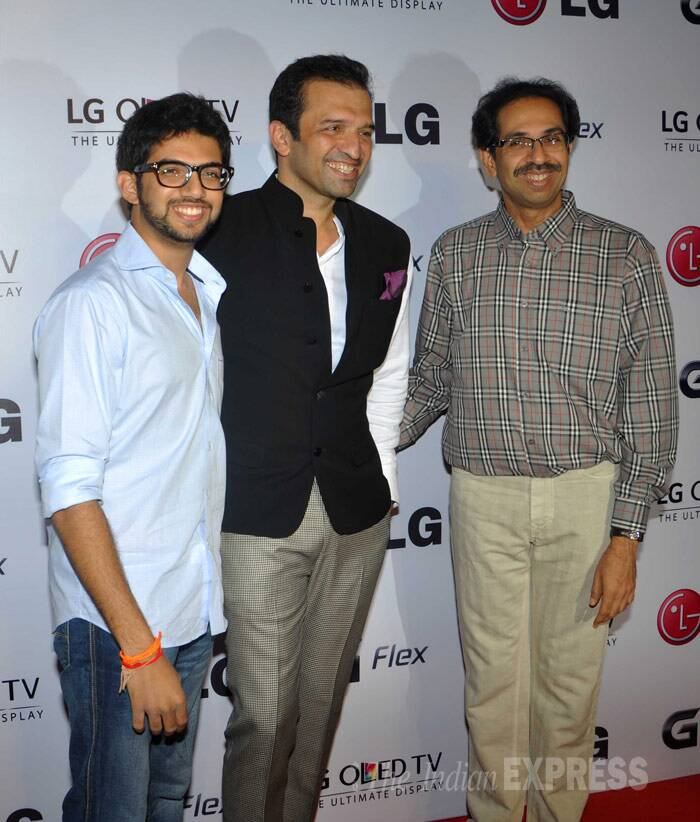 Photographer Atul Kasbekar flanked by Aditya Thackeray and his father Uddhav Thackeray. (Photo: Varinder Chawla)