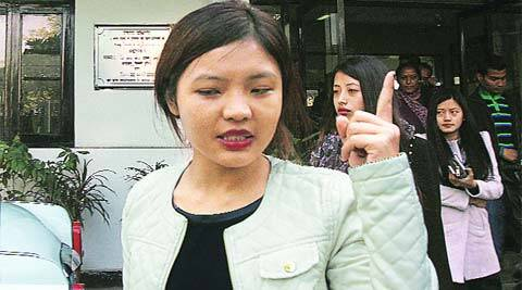 Nido Taniam's sister outside the Lajpat Nagar police station on Wednesday. (Amit Mehra)