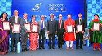 Kofi Annan and N R Narayana Murthy pose with Infosys Prize 2013 awardees at the presentation ceremony in Bangalore Saturday. (PTI)