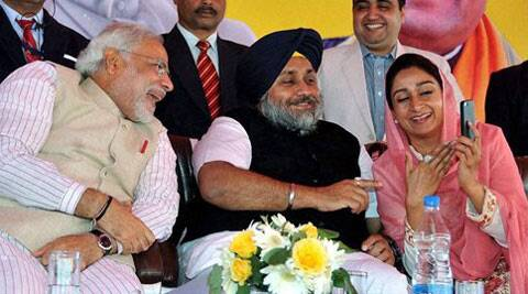 Harsimrat Kaur Badal (right) shares a stage with her husband, Sukhbir Singh Badal (center), and Narendra Modi at a joint election rally.