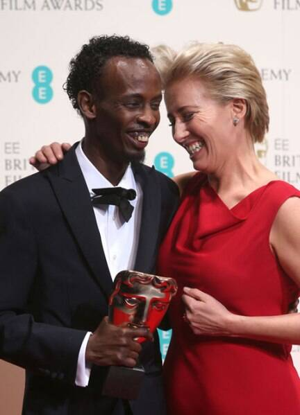 Barkhad Abdi, winner of best supporting actor and Emma Thompson pose for photographers at BAFTAs. (AP)
