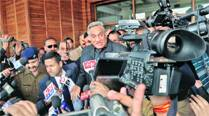 Vijay Bahuguna after submitting his resignation to Governor Aziz Qureshi, in Dehradun Friday. 	PTI