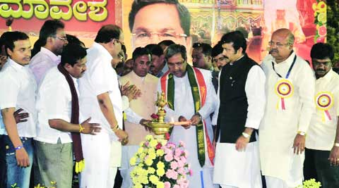 Chief Minister Siddaramaiah lights the lamp with Union Minister of State for Micro, Small and Medium Enterprises K H Muniyappa to inaugurate Karnataka State Tigala Bruhat Jagruthi Samavesha at National College Grounds in Bangalore Sunday. www.pics4news.com