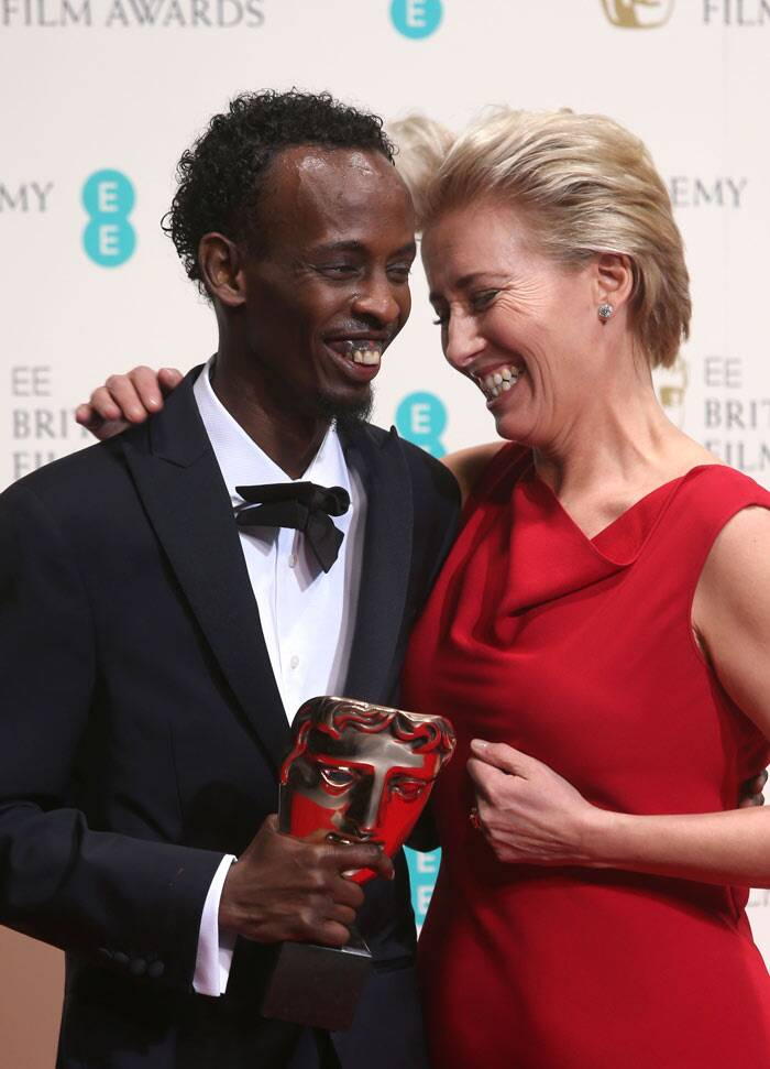 'Captain Phillips' actor Barkhad Abdi looks thrilled with his Best Supporting Actor Award as he celebrates with Emma Thompson.<br /><br /> Emma Thompson had presented the award for Best Supporting Actor to Barkhad Abdi for his role in Captain Phillips.  (AP)