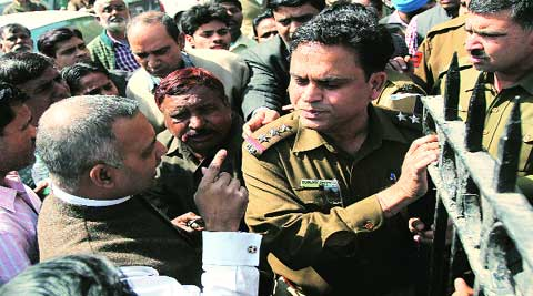 Former Delhi Law Minister Somnath Bharti (left) argues with police during the protest.Tashi Tobgyal